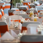 tables & orange sashes_set up